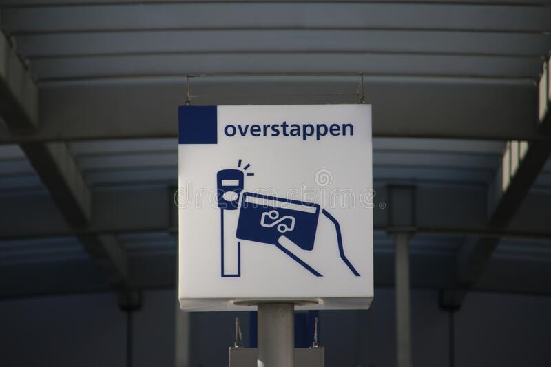 White and blue information sign at platform for transfer to internationa trains at Utrecht central station stock images