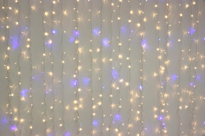 White Blue Led Neon Garland Hanging On The White Wall stock photography