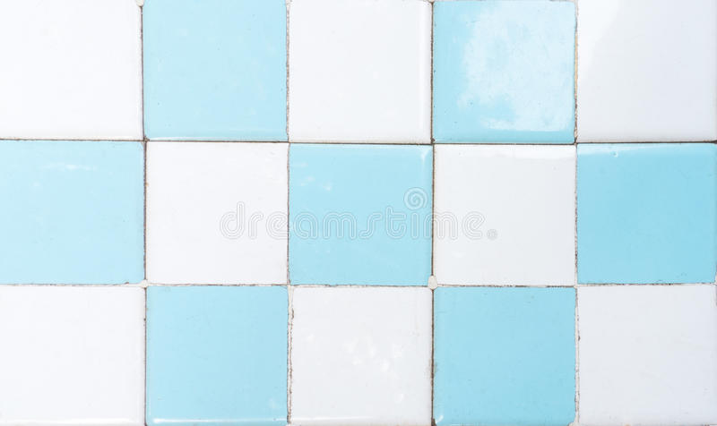 White and Blue Restroom Tile Wall with Chess Pattern. A White and Blue Restroom Tile Wall with Chess Pattern stock images