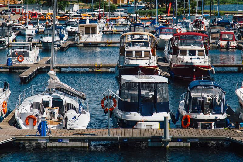 White Blue Sailboats Dock on Water during Daytime royalty free stock photos
