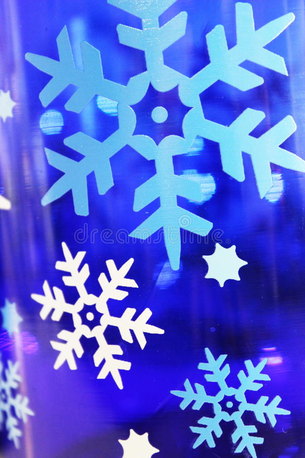 White and blue snowflake background or holiday background stock photos