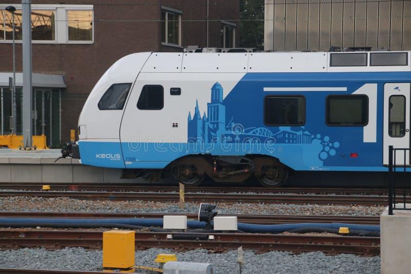 White Blue train of Blauwnet along platform at Zwolle station royalty free stock photo