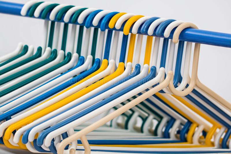 White Blue Yellow and Green Plastic Clothes Hanger royalty free stock photo