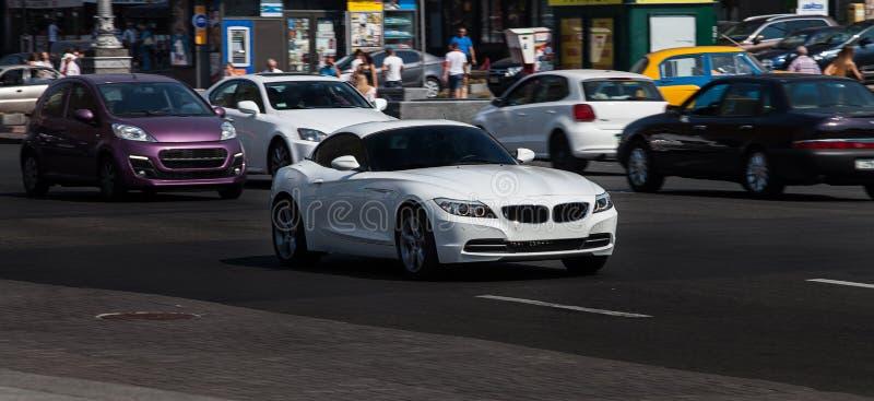 White BMW in city stock photo