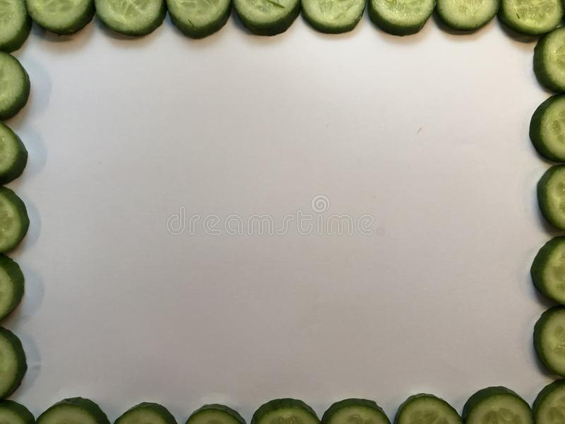 White board with sliced cucumber frame stock photography