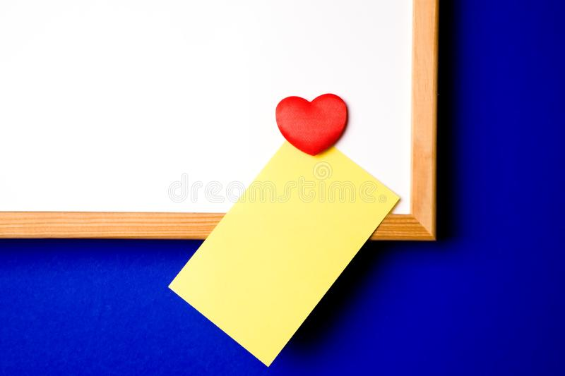 White-board with yellow note royalty free stock photo