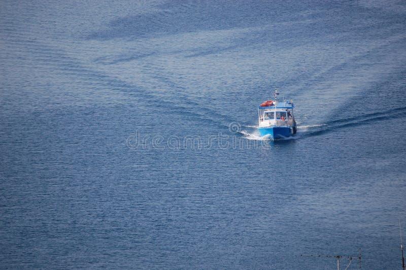 White boat on blue sea stock photos
