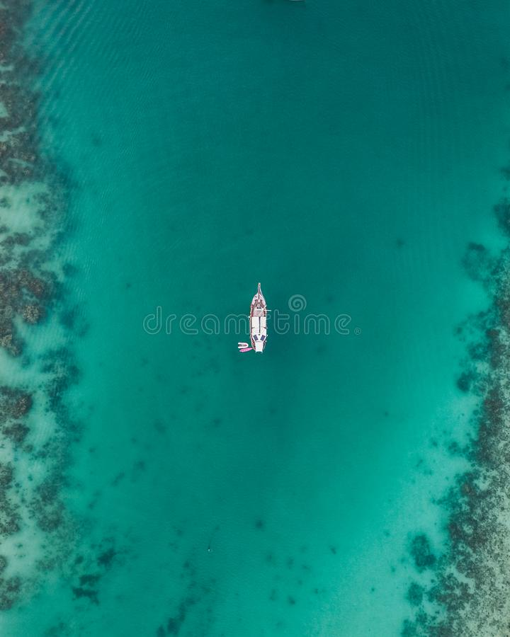 White Boat on Body of Water royalty free stock image