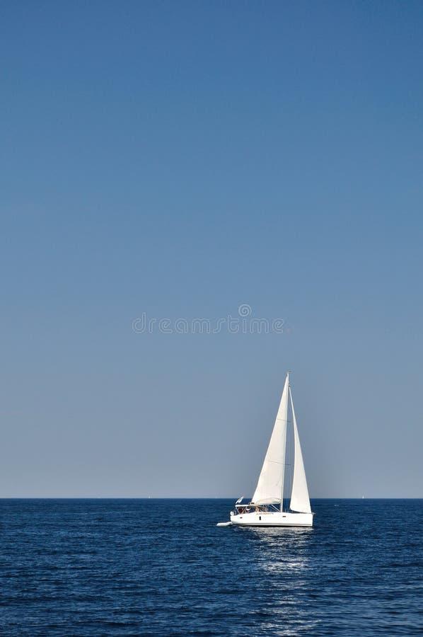 White boat on open blue sea, Croatia royalty free stock photo