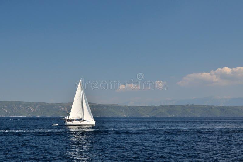 White boat on open blue sea, Croatia royalty free stock photos