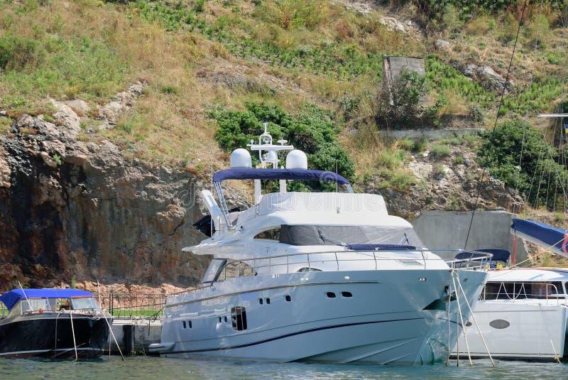 White boat over mountain royalty free stock photos