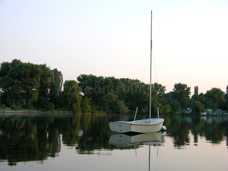 Download White Boat Reflecting Into Water Stock Images - Image: 148354