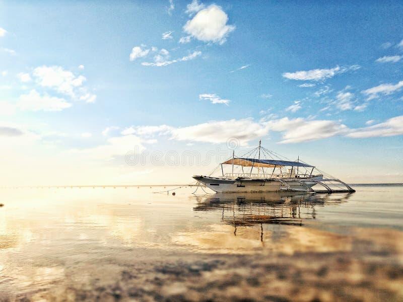 White Boat on Sea during Sunrise royalty free stock photo