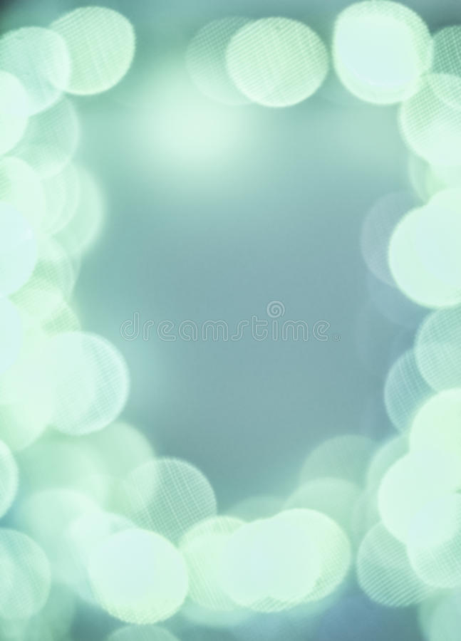 White bokeh circles with texture on turquoise background royalty free stock image