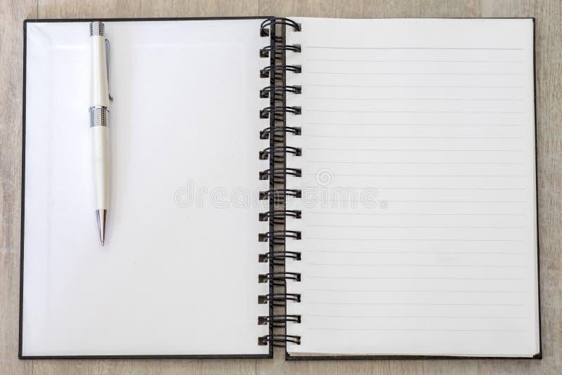 White book memo blank open line with pen. White book memo blank open striped line with white pen royalty free stock photos