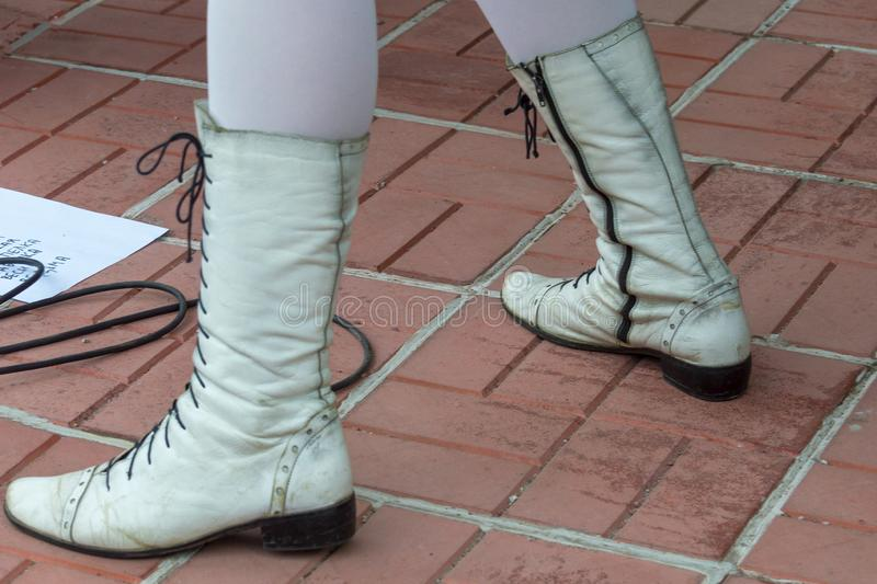 White boots and white tights on a woman. stock photography
