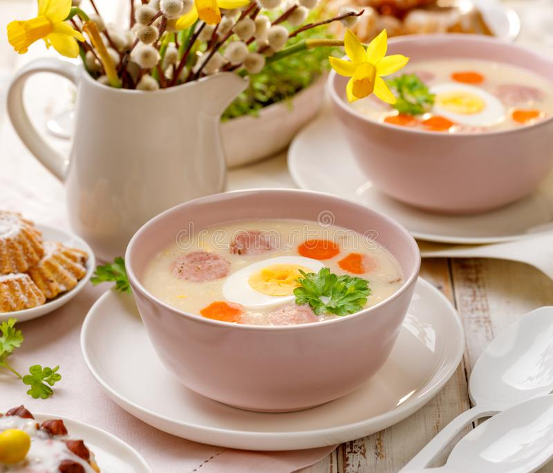 White borscht, polish Easter soup with the addition of white sausage and a hard boiled egg in a ceramic bowl. Traditional Easter dish in Poland stock photos