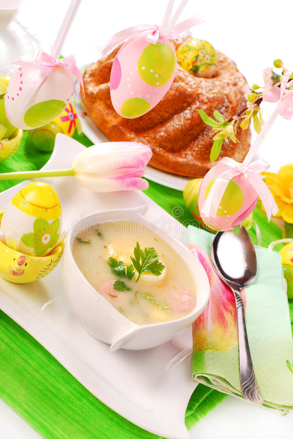 White borscht and ring cake on easter table royalty free stock photography