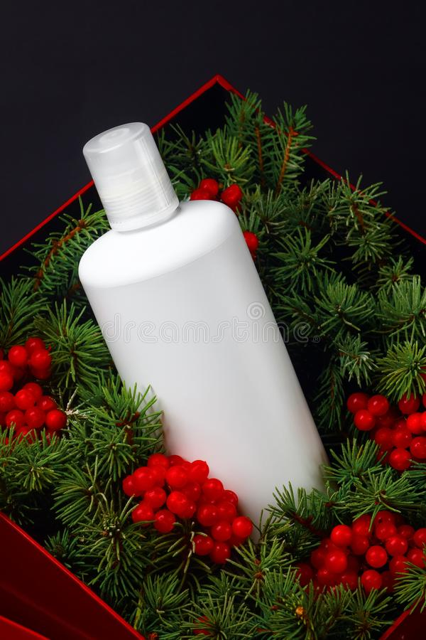 White bottle with organic, cosmetics winter product for hair care with natural ingredients. Eco friendly beauty industry stock images