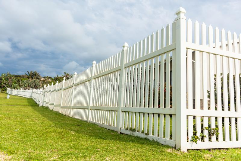 White Boundary Vertical Slat Fence stock photos
