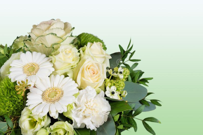 White bouquet of fresh flowers on green background. Close up of flower bouquet. Fresh cut flowers creation. Floral background. Flower artwork with white roses royalty free stock photo