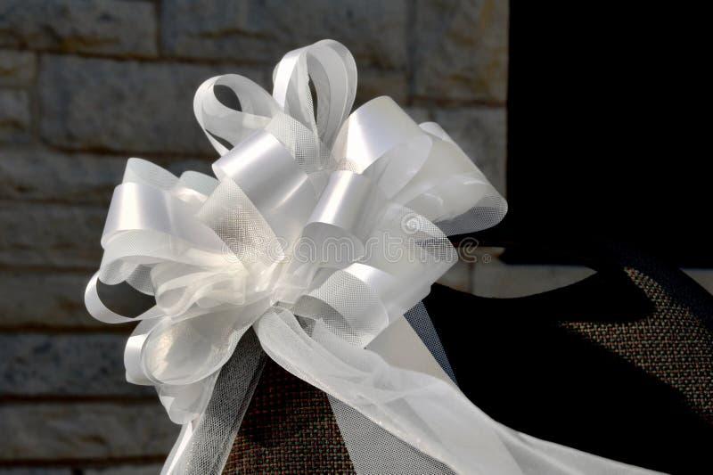 White bow at wedding stock photo
