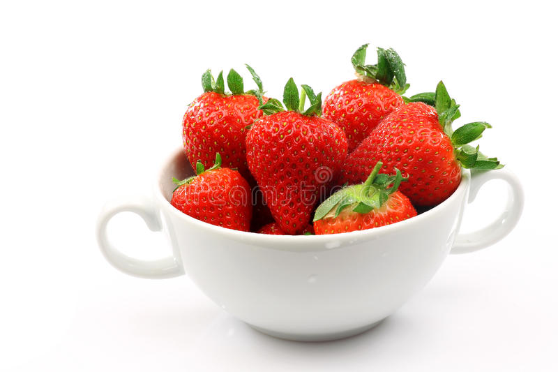 White bowl with strawberries stock images
