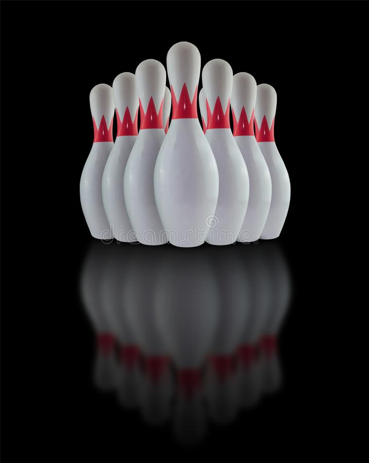 White Bowling pins. Isolated on black background royalty free stock photography