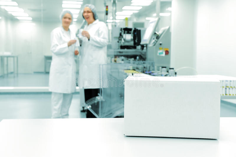 White box at automated production line. At modern factory stock photography