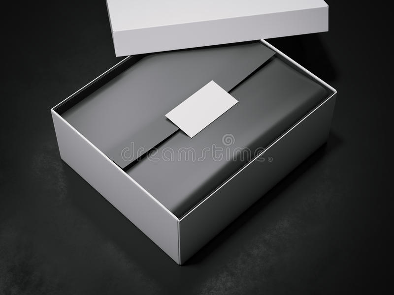 White box with black wrapping paper and business card. 3d rendering. White box with black wrapping paper and business card on dark background. 3d rendering royalty free illustration