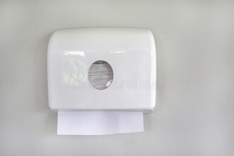 White box of tissues on wall in toilet royalty free stock image