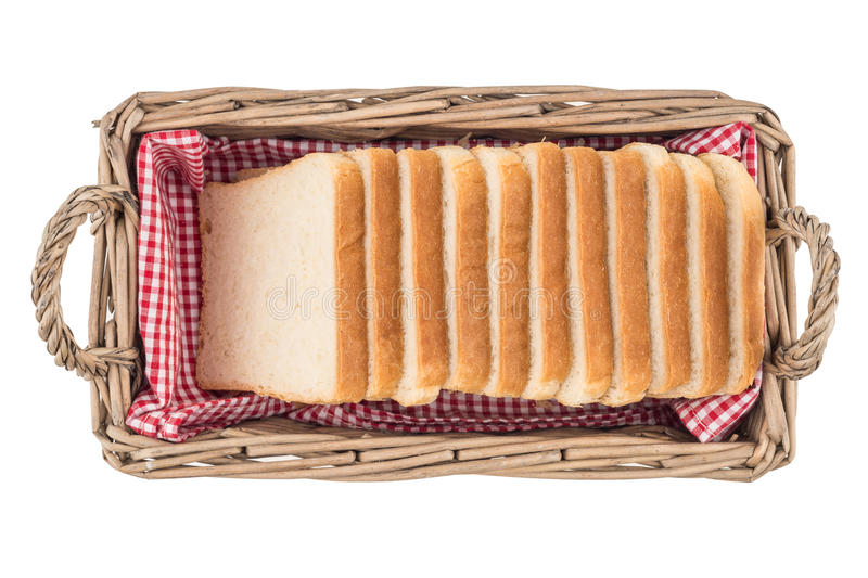 White bread in basket. Slice. Isolated on white background. stock photos