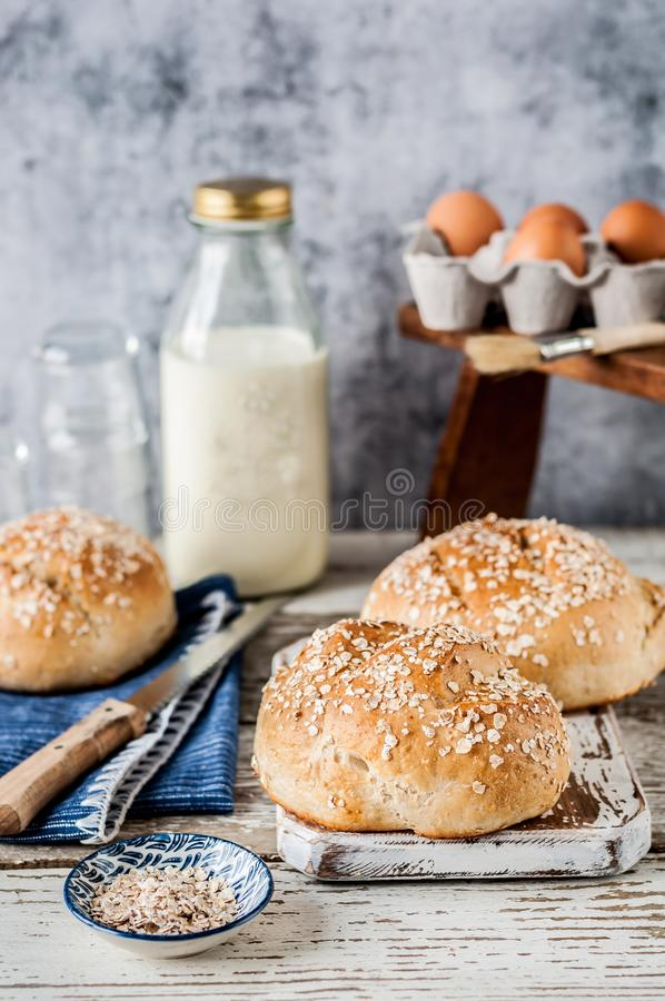 White Bread Buns with Rolled Oats stock photos