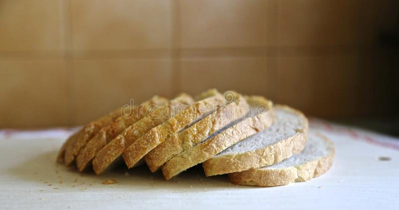 Fresh white without yeast  Mediterranean  bread is cut exactly by pieces for food and sandwiches. White bread is cut exactly on pieces a side view royalty free stock photography
