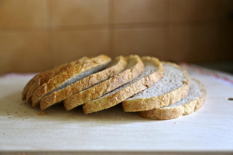 Fresh white without yeast  Mediterranean  bread is cut exactly by pieces for food and sandwiches. White bread is cut exactly on pieces a side view royalty free stock photos