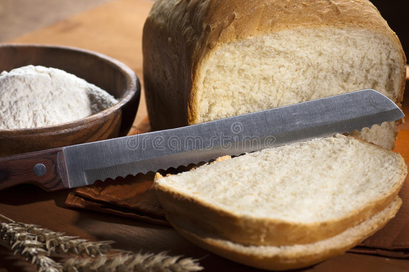 Download White bread with a knife stock photo. Image of crunchy - 23516324