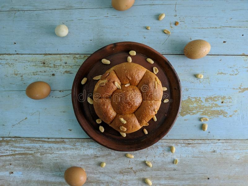 White bread with nuts on clay plate royalty free stock photos
