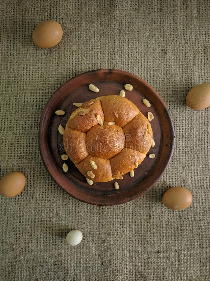 White bread with nuts on clay plate stock photo