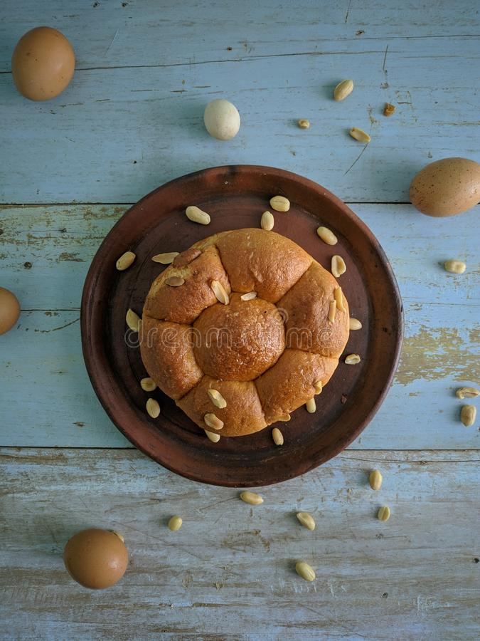 White bread with nuts on clay plate royalty free stock photo