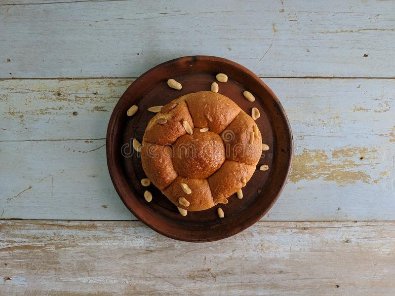 White bread with nuts on clay plate royalty free stock photography