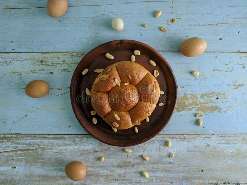 White bread with nuts on clay plate stock images
