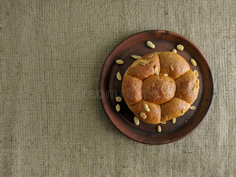 White bread with nuts on clay plate stock image