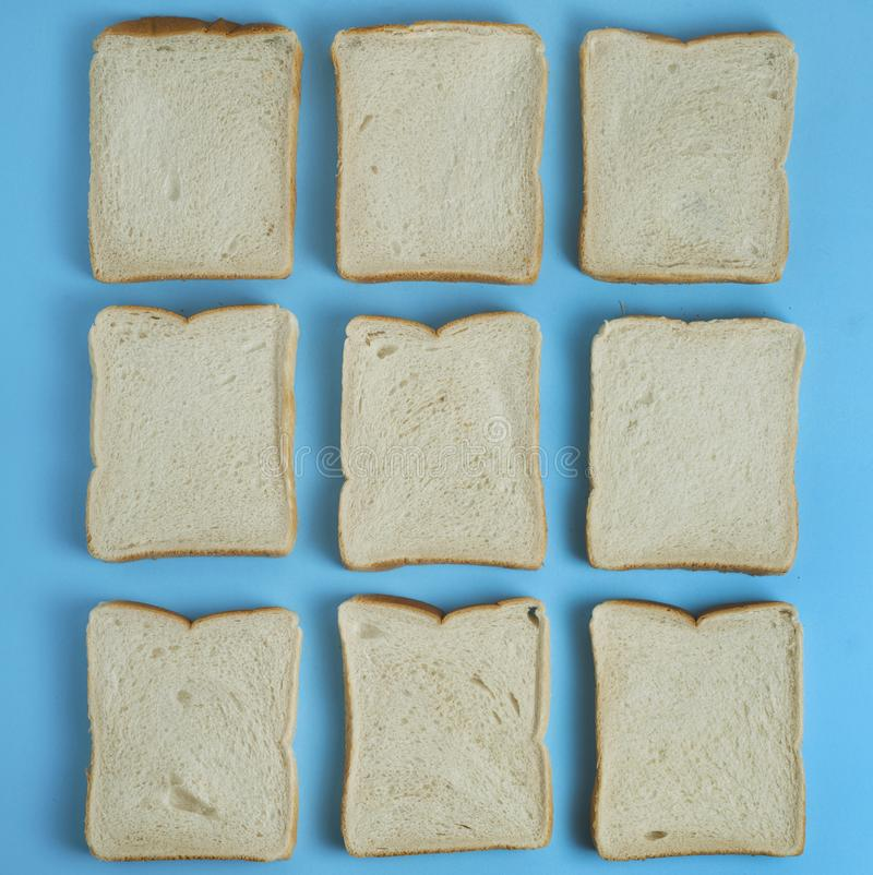 White Bread Toast Slices Isolated on Blue Background Texture Square Image. White Bread Toast Slices Isolated on Blue Background Texture stock photo