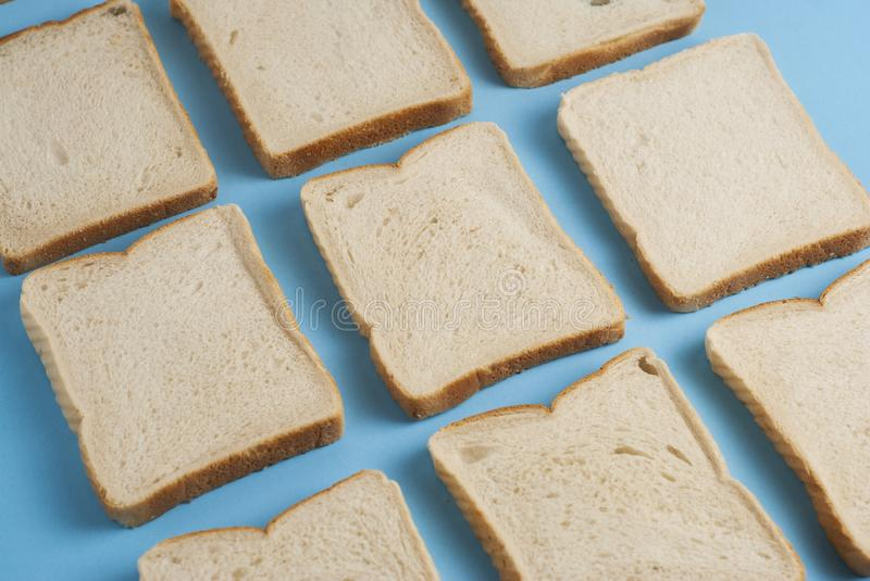 White Bread Toast Slices Isolated on Blue Background Texture Square Image. White Bread Toast Slices Isolated on Blue Background Texture stock photography