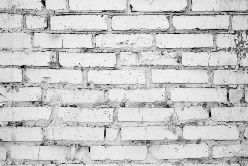 White brick cracked impure wall, background, texture stock photos