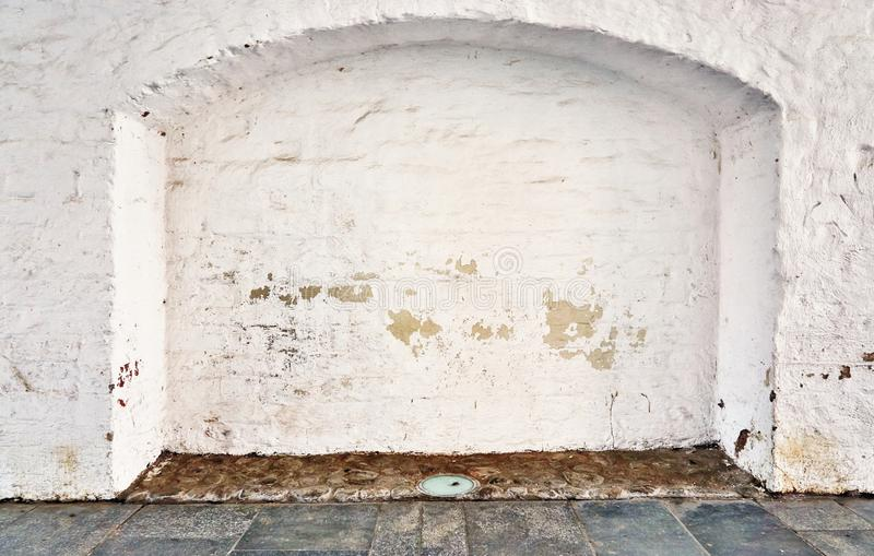 White brick wall with archway. Pattern, material, old, architecture, cement, structure, construction, block, solid, texture, background, building, space, rough royalty free stock photo