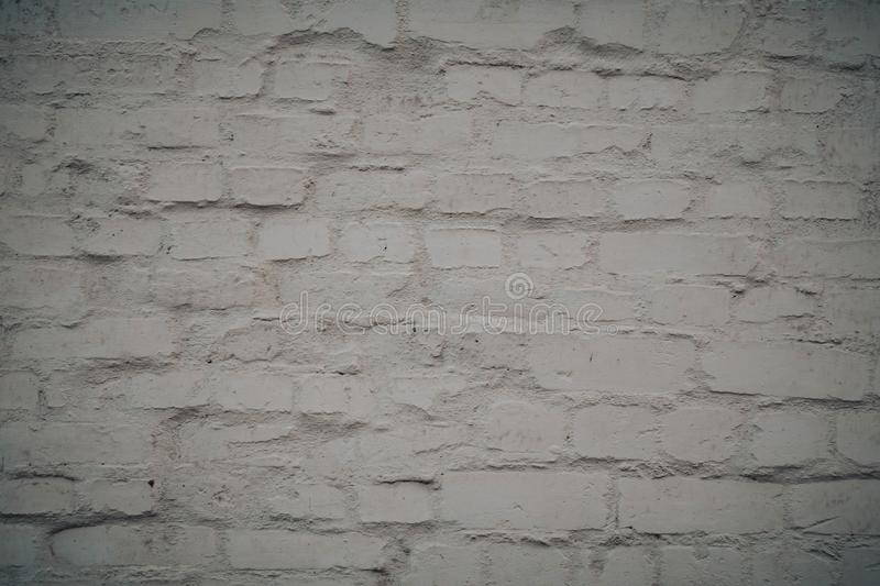 White brick wall background in rural room. Grunge design abstract frame pattern vintage texture broken cement concrete plaster rough surface stonewall obsolete royalty free stock photography