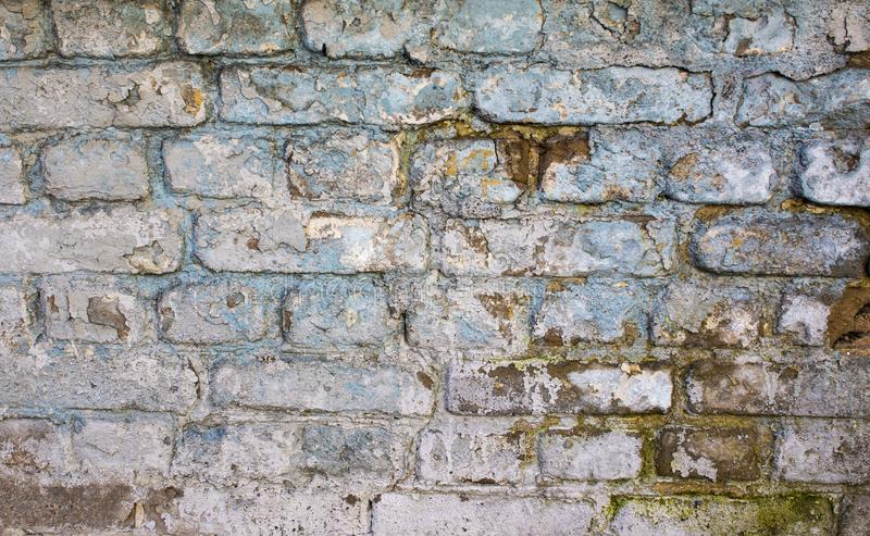 White brick wall background in rural room. Old brick wall with white and blue bricks background. vintage brick wall textur, rural, grunge, dirty, concrete, rough royalty free stock photo