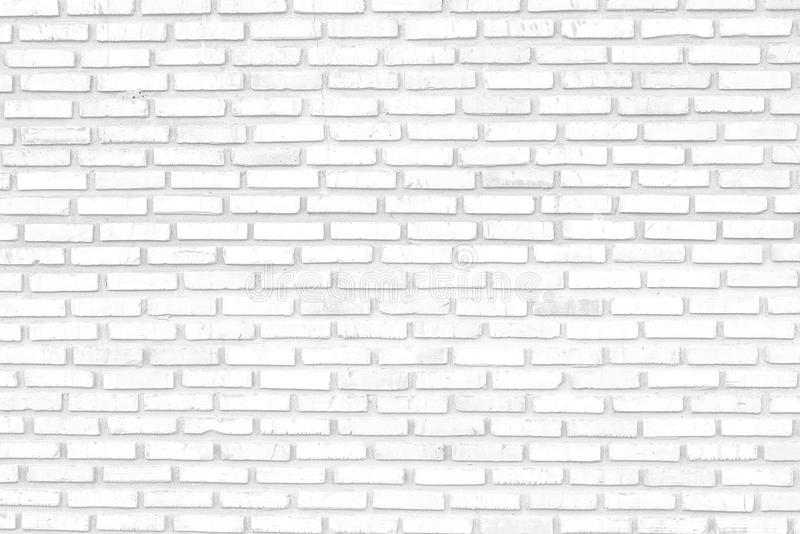 White brick wall background/white brick wall texture of modern ideal for background and used in interior design. White brick wall texture of modern ideal for stock images