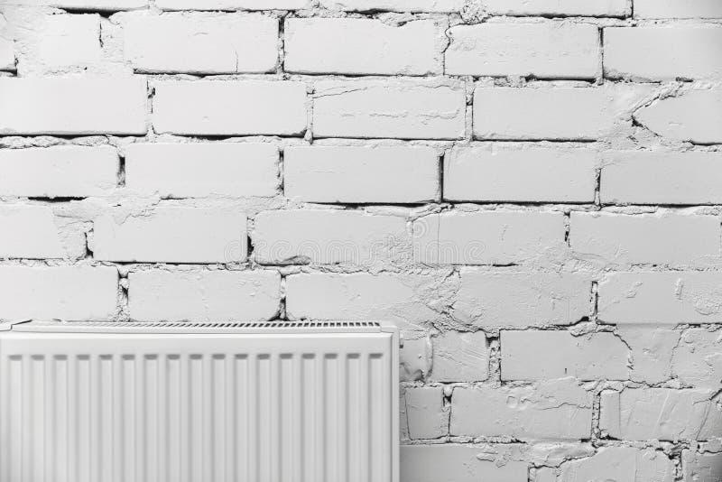 White brick wall with radiator. Interior shot with white brick wall with radiator stock image
